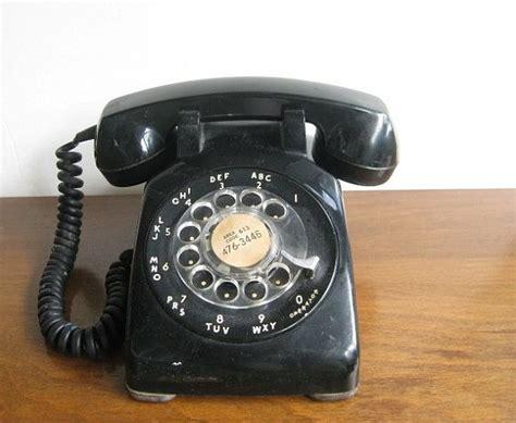 black phone number black rotary 1970s phone