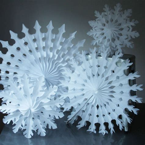 paper tissue snowflake christmas decorations by pearl and