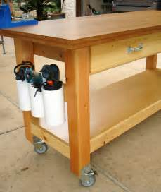 kitchen island with table attached white rolling workbench with quot drill holders quot diy