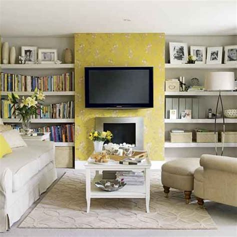 tv accent wall like the shelves to the sides of the tv a pretty yellow wallpaper accent wall living room