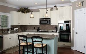 Blue and white kitchen by old white butlers bella tucker for Best brand of paint for kitchen cabinets with creative candle holders