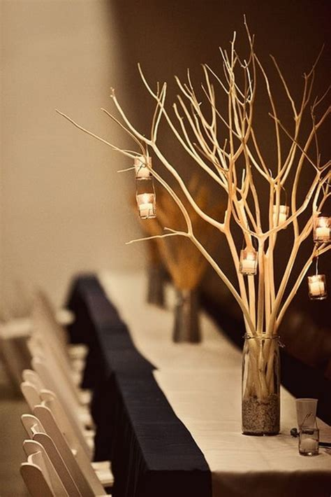 twigs and tea lights candle branch centerpiece wedding