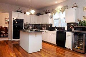 black appliances installed in the traditional kitchen featured white cabinets 1511