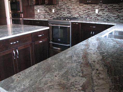 netuno bordeaux granite on cherry espresso cabinets