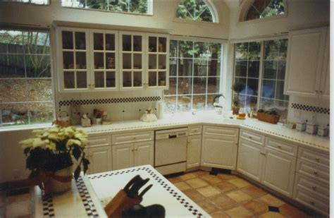 kitchen  white cabinets tile floor  tile counters