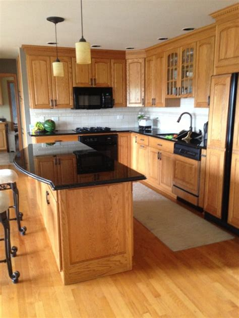 Kitchen Backsplash With Golden Oak Cabinets by Should I Paint My Golden Oak Cabinets