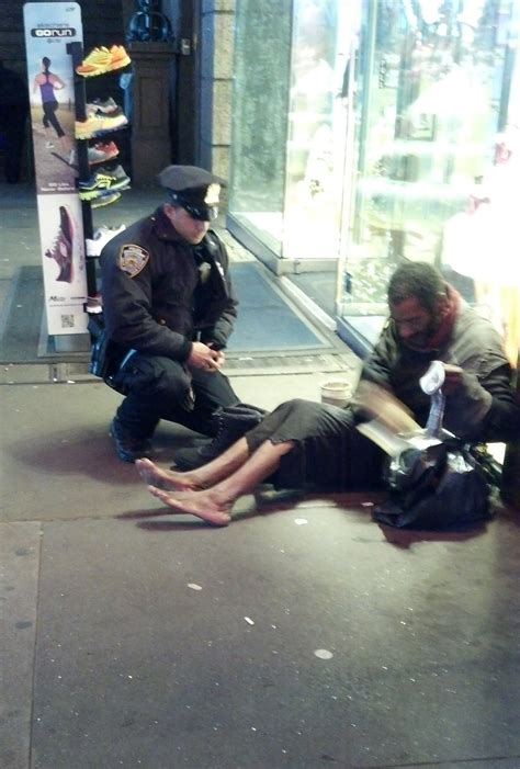 photo  officer giving boots  barefoot man warms hearts