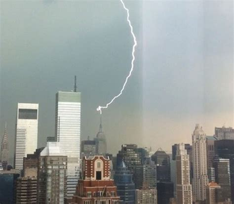 lightning strike atop empire state building punctuates sweltering day  city  promise