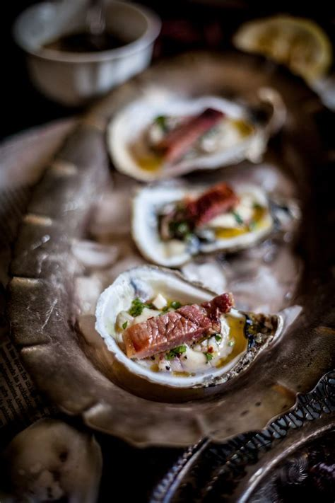 mignonette cuisine grilled oysters on the half shell with grilled proscuitto
