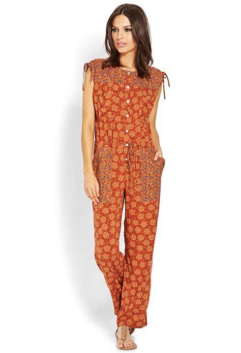 retro jumpsuit forever 21 retro patched jumpsuit in orange rust navy lyst