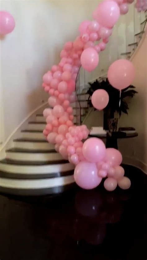 staircase  decked   pink balloons