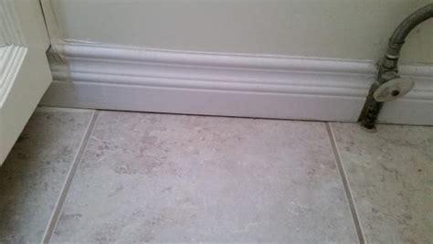 fill   crack   wall  floor   tiled