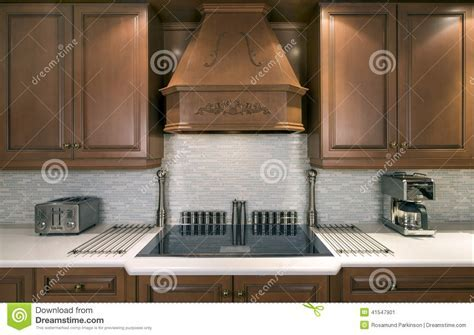 Kitchen Cabinets And Cooktop Stock Image   Image of tile