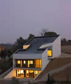 inspiring sloping site home designs photo concrete house embedded in the slope architects house