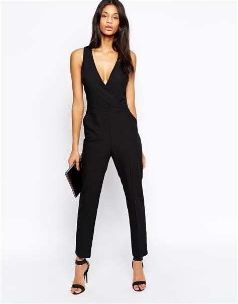 asos black jumpsuit asos jumpsuit with chic wrap in black lyst