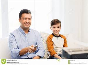 Smiling Father And Son Watching Tv At Home Stock Photo ...