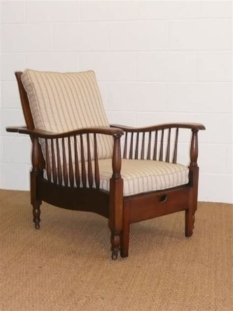 pair of arts crafts oak recliner armchairs 103002