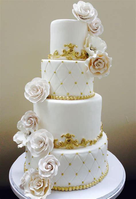 white wedding cake  gold accents wedding cakes