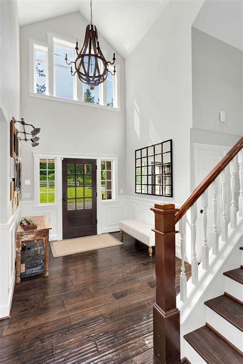 foyer chandelier dramatic two story foyer in this modern farmhouse Farmhouse