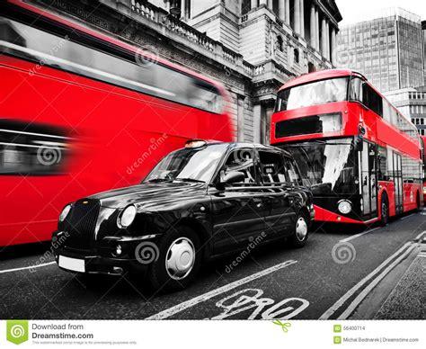 symbols  london  uk red buses black taxi cab black  white stock photo image