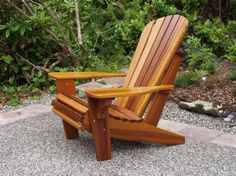 a pea gravel seating area with adirondack chairs and a