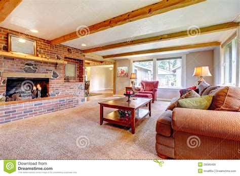 living room interior with brick fireplace wood beams and red royalty free stock images image