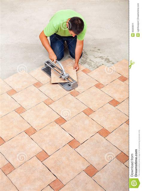 laying ceramic floor tiles stock image image 35003611