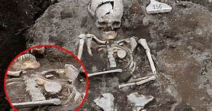 'Vampire' skeleton with stake driven through heart ...