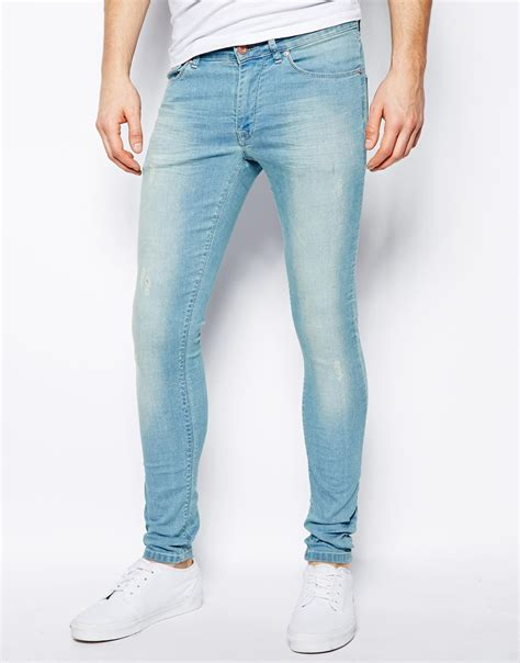 light jeans mens lyst asos extreme super skinny jean in light wash in