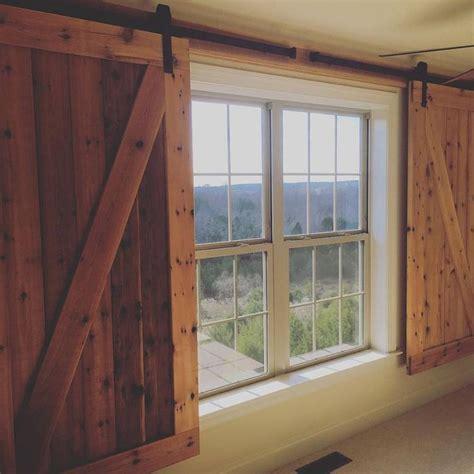 Barn Door Window by Barn Door Hangers Used To Create Window Coverings In A