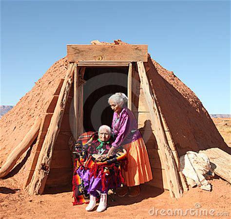 navajo women   traditional hogan hut stock