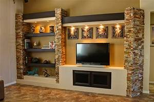 drywall entertainment center with exposed wood beams ...