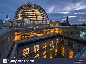 Modern architecture of glass dome structure at twilight ...