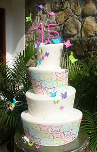 4 tier white topsy turvy 15th birthday cake with ...