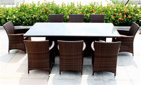 Excellent Patio Outdoor Dining Table Combined With Brown Fabric Cushion Seat Chairs With Black
