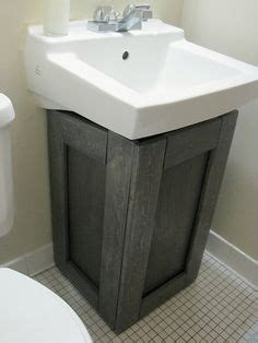 wood kitchen cabinets cool idea for the sink and it would hide the 3459