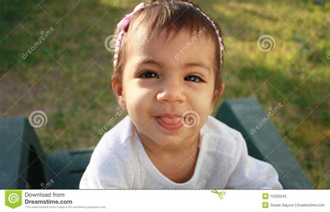 Baby Sticking Tongue Out Stock Photography Image 12350242