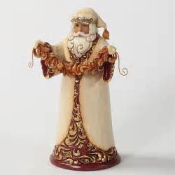 gold and burgundy santa claus with garland jim shore heartwood creek christmas figurine