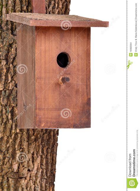 wooden bird housestarling houseon tree trunk stock photo