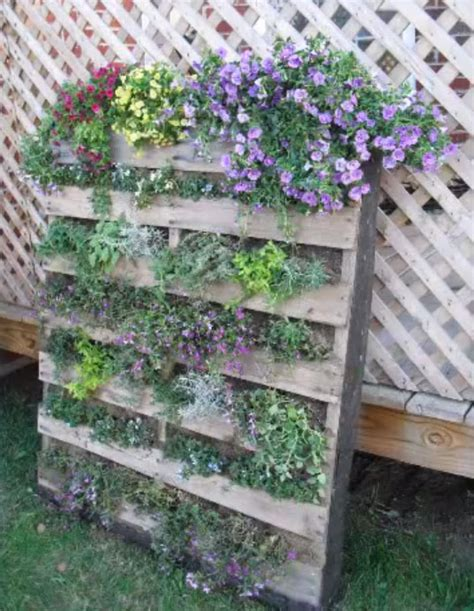 How To Make A Vertical Pallet Garden by Upcycle Pallets To Make Beautiful Vertical Gardens