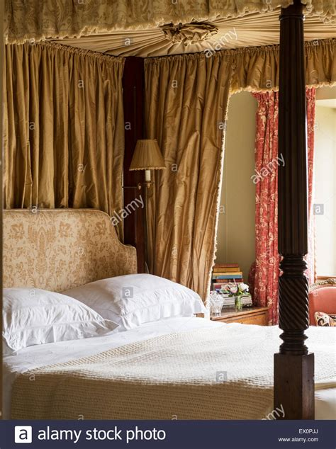 Four Poster Drapes - georgian four poster bed in bedroom with toile de jouy