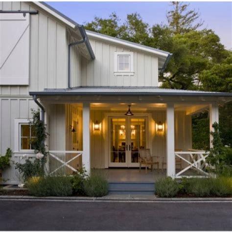 modern farmhouse front porches  sliding barn doors