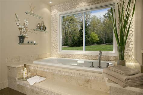 modern master bathroom with drop in bathtub by