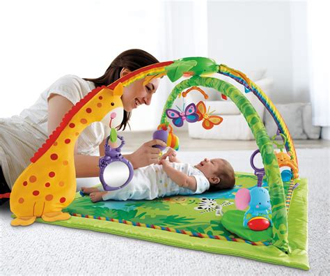 tapis de la jungle fisher price fisher price rainforest melodies and lights deluxe early development playmats