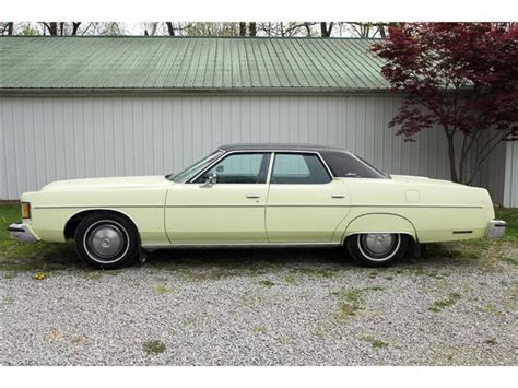 seller  classic cars  mercury monterey yellowgreen