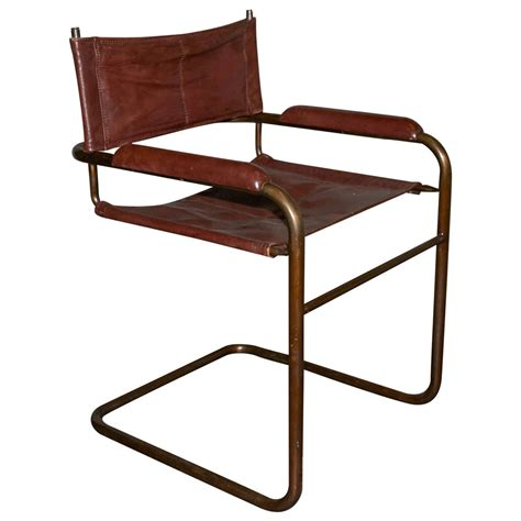set of four brass and leather cantilevered chairs at 1stdibs