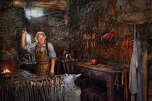Blacksmith - Working The Forge Photograph by Mike Savad