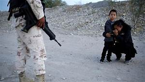 Photo Of Mother Pleading With Mexican Soldier Draws ...