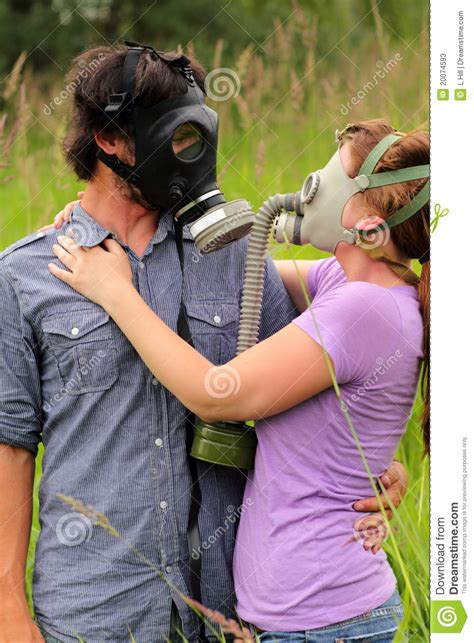 young couple  love wearing gas masks stock