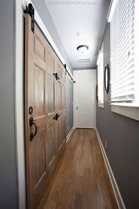 rustic meets refined upstairs hallway laundry sliding With barn door for hallway